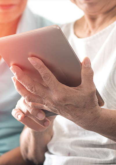 Senior woman holding a tablet